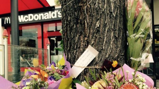 Flowers left at the scene of the attack on Joshua Hardy.