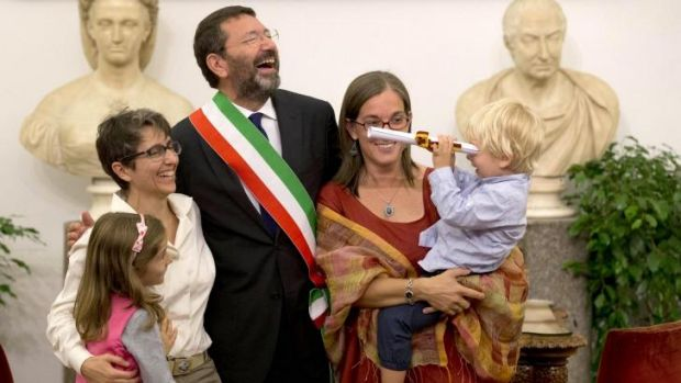 Rome mayor Ignazio Marino celebrates with   Costanza Tantillo (left) and her partner Monia di Giuseppe and their ...