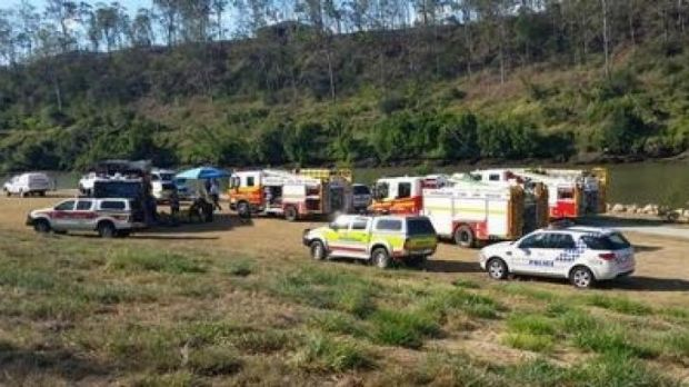 Emergency crews search for a man missing in the Brisbane River at Karana Downs.