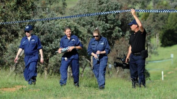 Police forensic team at a crime scene at Jerrabomberra Creek near the corner of Hindmarsh Drive and the Monaro Highway ...
