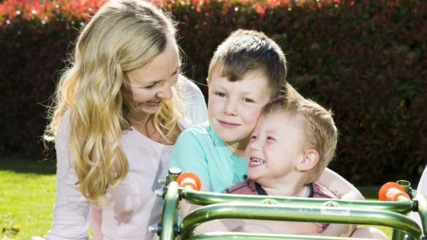 US surgery: Ollie Lanham, 2, with his mother Angela Patch and brother Elliot, 6.