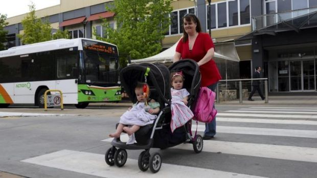 Heather Tricker with  daughters Portia, front and Charlotte, says she would would support a Canberra-wide network.
