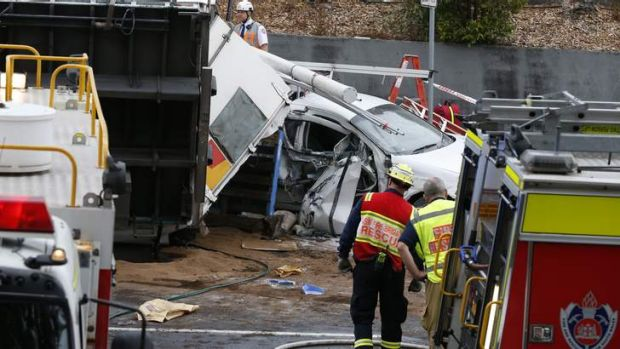 A car is stuck under the truck in Sydney's north.