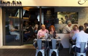 Diners spill onto the pavement at love.fish in Rozelle.