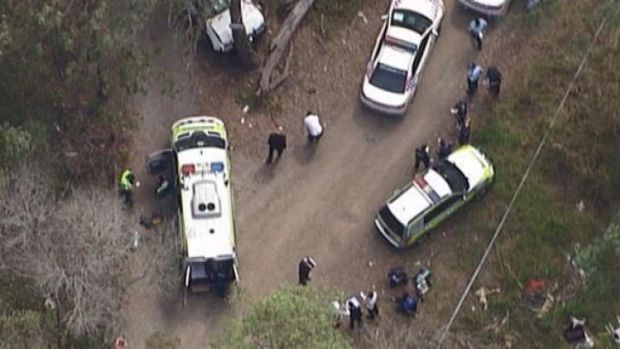 Police and emergency crews at the scene of a police shooting in Rochedale South.