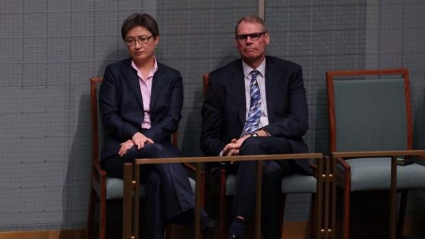 Labor senators Penny Wong and John Faulkner listen to MPs pay tribute to Mr Whitlam in the House of Representatives.