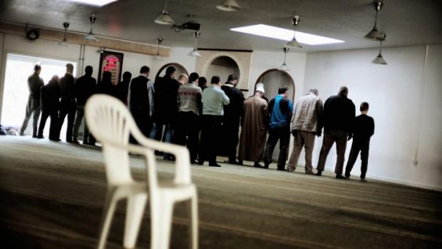 Muslims gather for afternoon prayer at the Grimjohvej mosque: Its leadership has denied it recruits fighters.