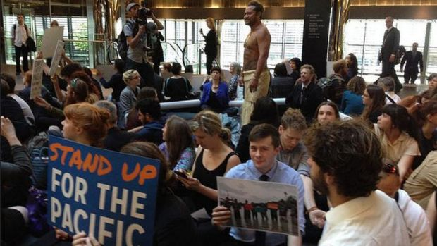 About 80 people occupy ANZ headquarters to protest the bank's financing of new fossil fuel and its impact on Pacific Islands.