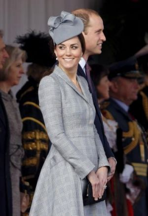 The Duchess wore a grey Alexander McQueen coat and matching coloured hat by Jane Taylor.