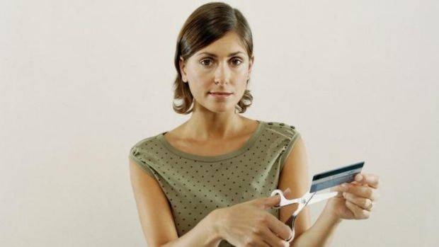 Cut it out: Get rid of your credit card debt in one easy snip.
