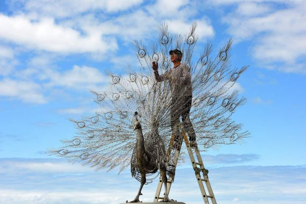 """Artist Byeong Doo Moon with his sculpture """"Our Memory in Your Place"""""""