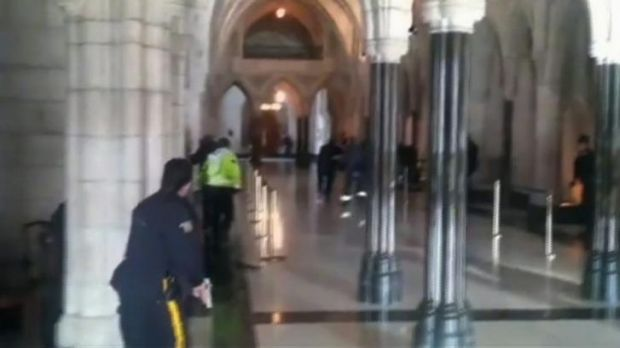 Police officers respond to shooting attacks inside the Centre Block of the parliament buildings in Ottawa.