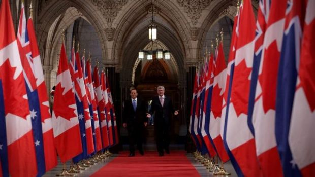 Prime Minister Tony Abbott and Canadian Prime Minister Stephen Harper walk the Hall of Honour earlier this year.