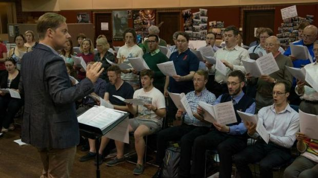 Under threat: Andrew Wailes with the Royal Melbourne Philharmonic Choir which is facing a funding crisis.