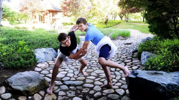 In a bind: Sumo wrestlers Oscar Skrbinsek,13 and Matt Duncan,12 both of Forrest at the Canberra Nara Peace Park.