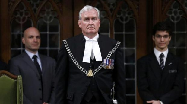 Hailed as a hero ... Canada's Sergeant-at-Arms Kevin Vickers is applauded in the House of Commons in Ottawa. Vickers ...