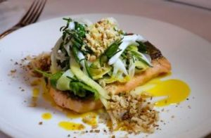 Trout with a fennel and cuttlefish salad, saffron and orange pangrattato.