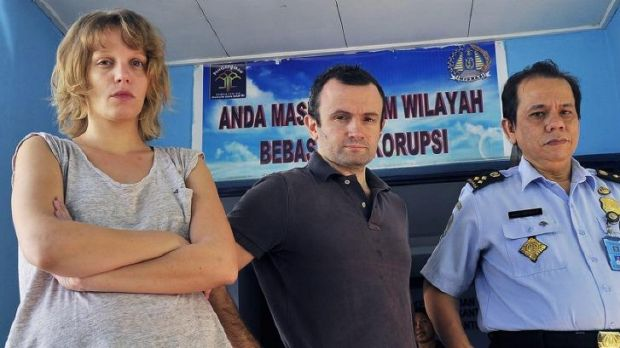 Jailed: French journalists Valentine Bourrat and Thomas Dandois pictured with an Indonesian immigration official in Papua.