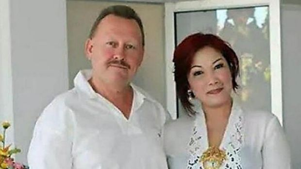 Happier times: Bob Ellis with his wife Julaikah Noor Aini, who is a prime suspect in his murder.