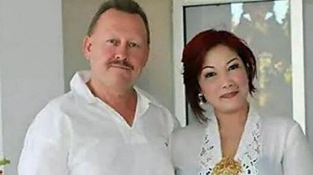 KILLED IN BALI: Robert Kelvin Ellis, pictured with his wife Julaikah Noor Aini, was found with his throat slashed.