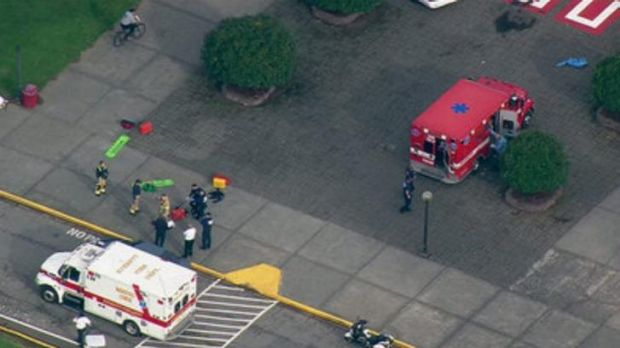 This image made from a video provided by KOMO shows emergency personnel responding after reports of a shooting at ...