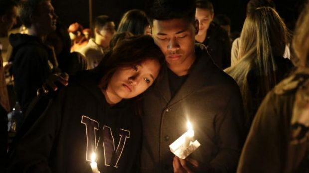 Students and community members attend a vigil after the shooting.