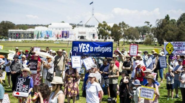 SUNDAY RALLY: Supporters of refugees' rights march to Parliament House.