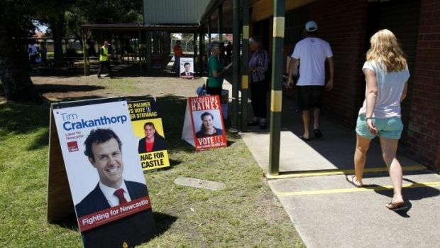 Decision time: Voters arrive at Stockton Public School to vote in the Newcastle byelection.