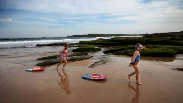 Keeping an eye out: Isla, 5, and Alicia, 6, at Maroubra Beach, where a shark was caught earlier this year.