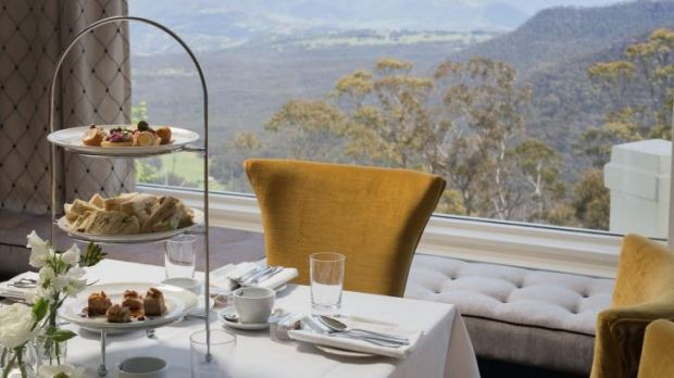 A tasty view: High tea is served with stunning scenery in the background.