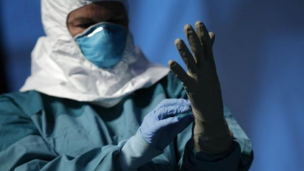 Gearing up: A nurse demonstrates protective equipment during an Ebola educational session for healthcare workers in New York.