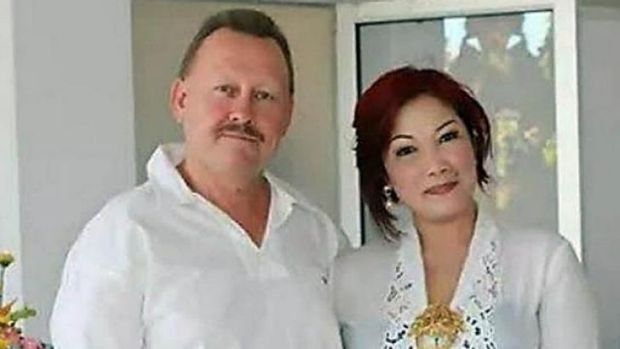 Bob Ellis with his wife Julaikah Noor Aini, who is a prime suspect in his murder.
