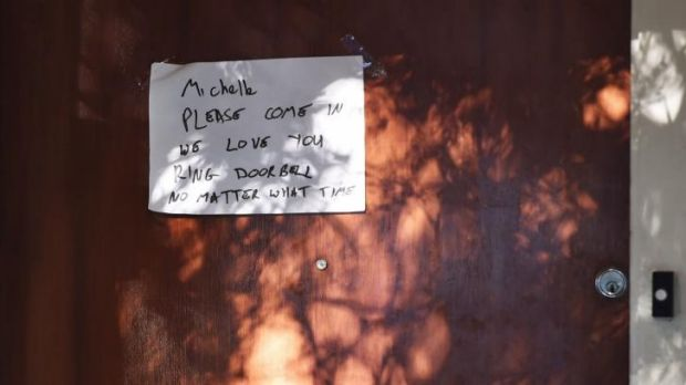 A note posted on the front door of the Levy family home.