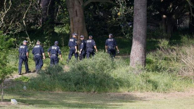 Police search the more remote corners of Centennial Park for Michelle Levy on Sunday.