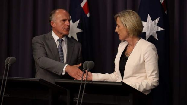 ACT Chief Minister Katy Gallagher and Senator Eric Abetz during a press conference about a loan to resolve the Mr Fluffy ...