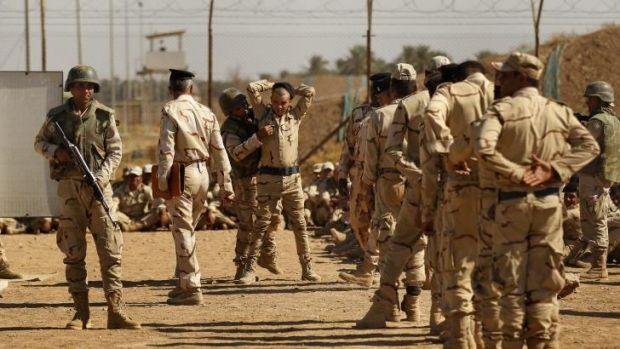 Iraq army recruits during a training session in how to search people at Camp Taji.