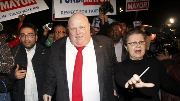 Rob Ford leaves the hall after speaking to supporters after being elected as a councillor in the municipal election in ...