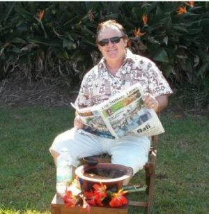 In this image supplied by Peter Foster, the conman is seen reading the Fiji Sunday Times newspaper with what he claims ...