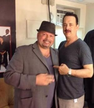 Manny Anzalota posing backstage with Tom Hanks after seeing his show, Lucky Guy.
