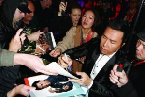 In demand: Donnie Yen autographs posters at the London Film Festival.
