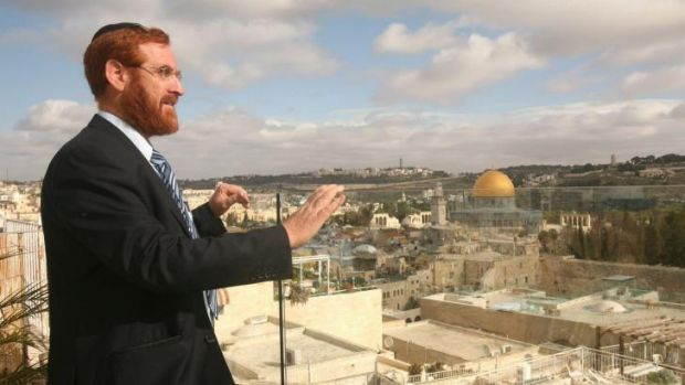 A 2010 photo shows Rabbi Yehuda Glick in Jerusalem on a rooftop overlooking the Old City. The golden Dome of the Rock, ...