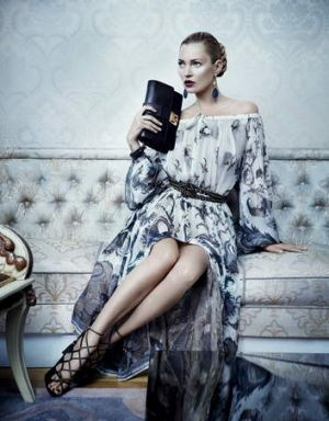 Kate Moss hits the couch for Ferragamo in 2012.