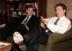 Tony Blair gets comfy discussing the 2006 World Cup with England soccer coach Glenn Hoddle.