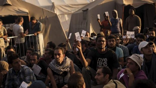 Push factors: Refugees from Syria, Gambia, Eritrea, Iraq and other countries wait to be transferred to temporary ...
