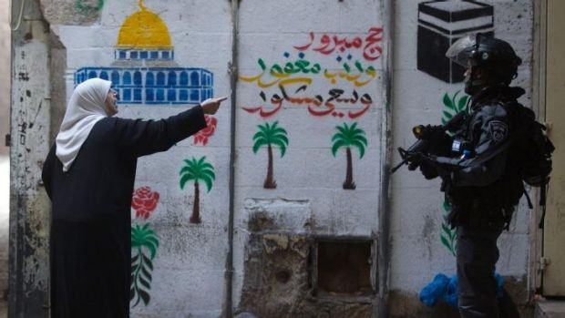A Palestinian woman confronts an Israeli policeman in Jerusalem's Old City.