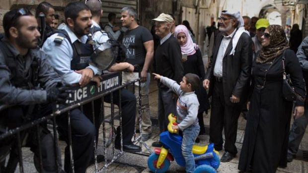 Israeli police prevent Palestinians from entering the precincts of the al-Aqsa Mosque in occupied East Jerusalem.