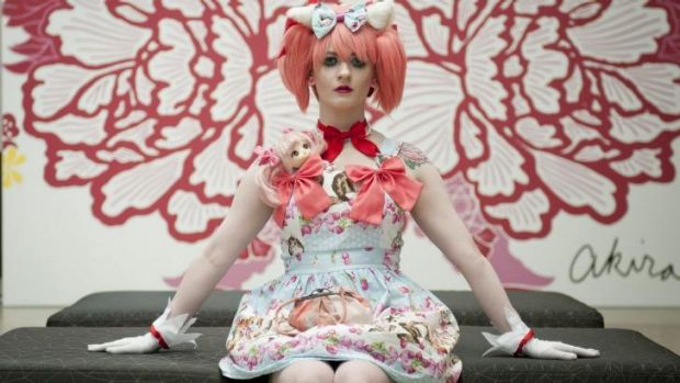Claire Fulton poses for a portrait during the preview of 'Future beauty: 30 years of Japanese fashion' exhibition at GOMA.