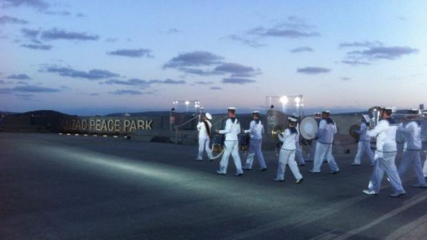 Remembering them, 100 years on: The Royal Australian navy performs the sunset ceremony.