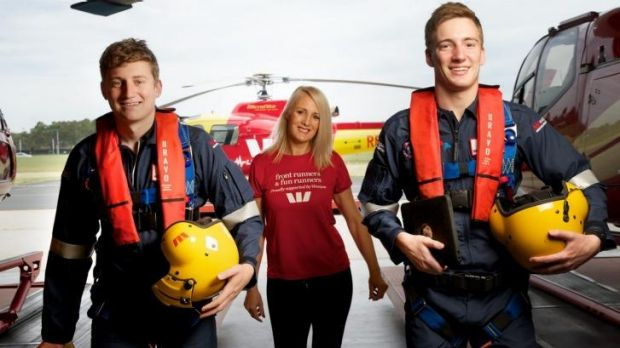 Westpac rescue helicopter crewmen Ashley Baxter and Brendan Smart with Sue Pappas.