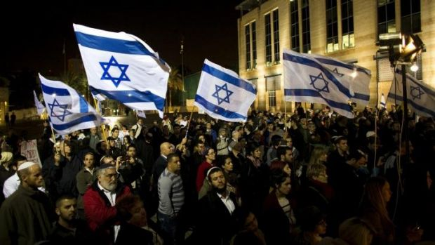 Israeli activists from the religious right attend a prayer rally in Jerusalem for the recovery of Rabbi Yehuda Glick, ...